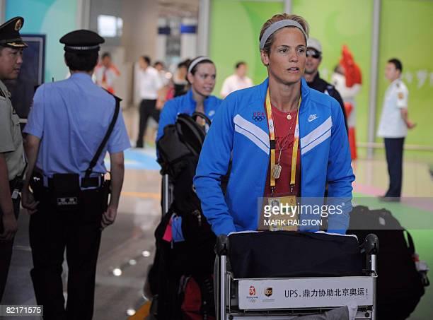 US swimmer Dara Torres arrives at the Beijing International airport for the Olympic Games on August 4 2008 The US swim team are chomping at the bit...