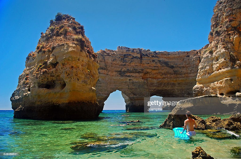 Swimmer discovering Marinha beach : Stock Photo