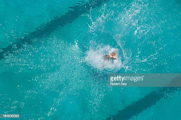 Swimmer diving in pool