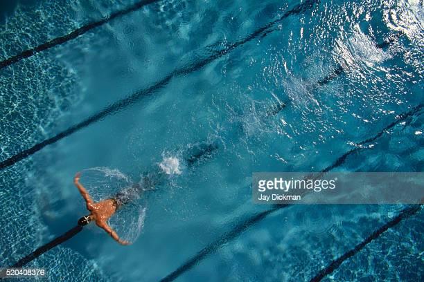 swimmer doing butterfly stroke - バタフライ ストックフォトと画像