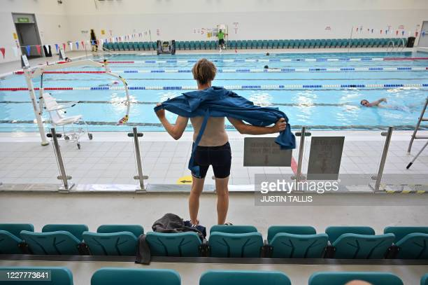 Swimmer dries themselves after swimming in the pool at Kensington Leisure Centre in west London on July 25, 2020 as novel coronavirus lockdown...