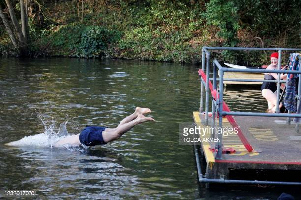 Swimmer enters the water at the Hampstead Heath ponds in London on March 30 as Covid-19 lockdown restrictions ease to allow outdoor activities,