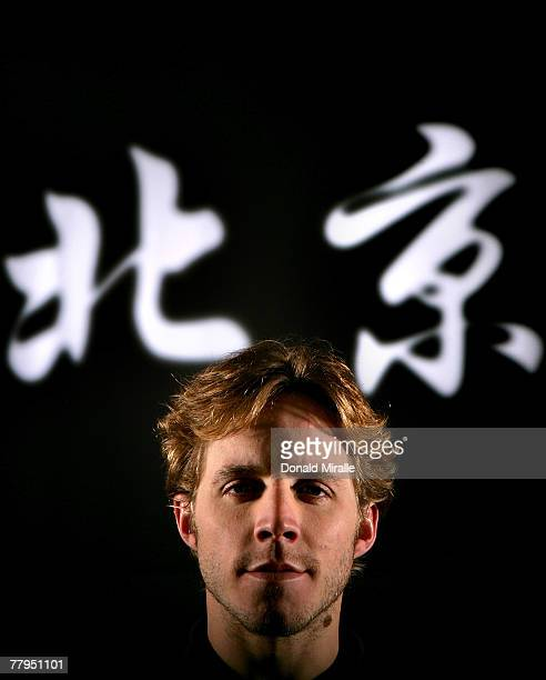 Swimmer Erik Vendt poses for a portrait in front of Chinese characters reading Beijing during the Athlete Summit at Smashbox Studios on November 16...