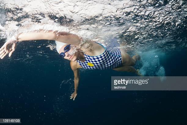 Swimmer exhaling underwater