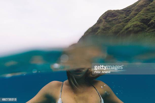 Swimmer floating near surface of sea