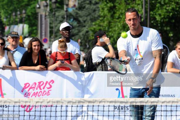 A swimmer Frederic Bousquet plays tennis on Alexandre III bridge as Paris promotes its candidacy for the 2024 Summer Olympic and Paralympic Games on...
