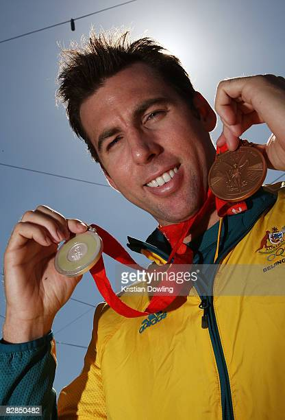 Swimmer Grant Hackett poses with his medals during a welcome home parade for the Beijing 2008 Olympic Athletes at Federation Square on September 17...