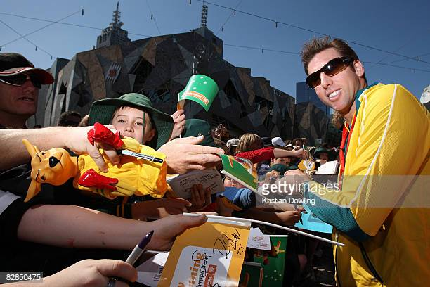Swimmer Grant Hackett signs autographs for fans during a welcome home parade for the Beijing 2008 Olympic Athletes at Federation Square on September...