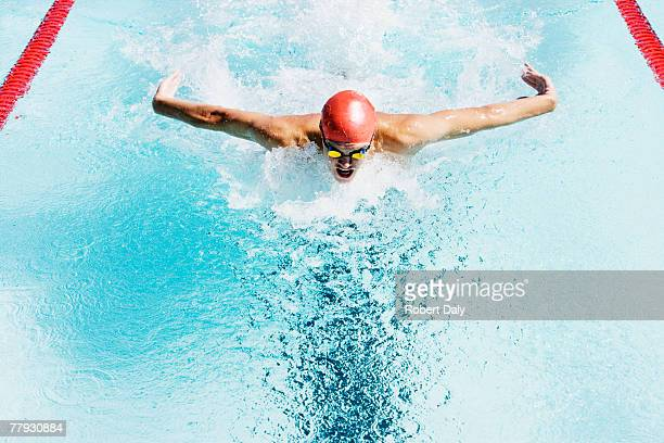 swimmer in a pool - aquatic sport stock pictures, royalty-free photos & images