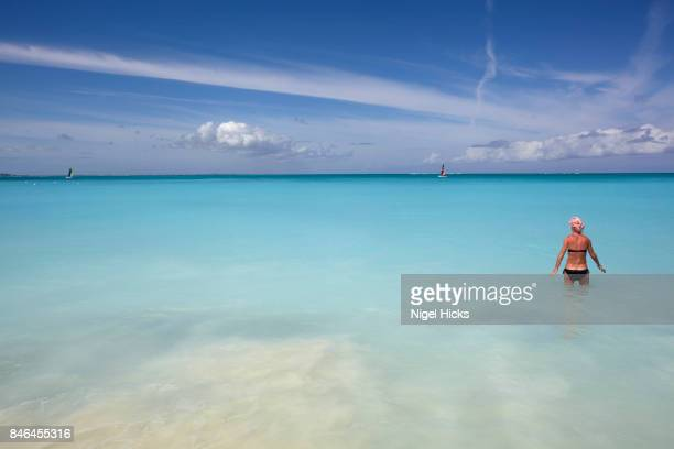 A swimmer in the stunning azure sea in Grace Bay, Providenciales, Turks and Caicos.