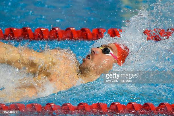 Swimmer Jeremy Stravius competes in the Men's 50meters backstroke final at the 25m French swimming championships in Montpellier on December 3 2017 /...
