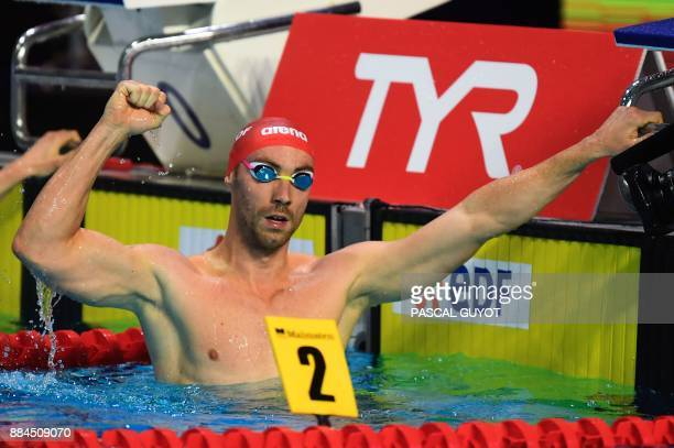 Swimmer Jeremy Stravius reacts after winning the final of the men's 200meters freestyle at the 25m French swimming championships in Montpellier on...