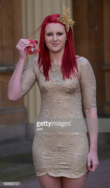 Swimmer Jessica JaneApplegate poses for photographs after she received an MBE at Buckingham Palace in London on March 12 2013 AFP PHOTO/POOL/Stefan...