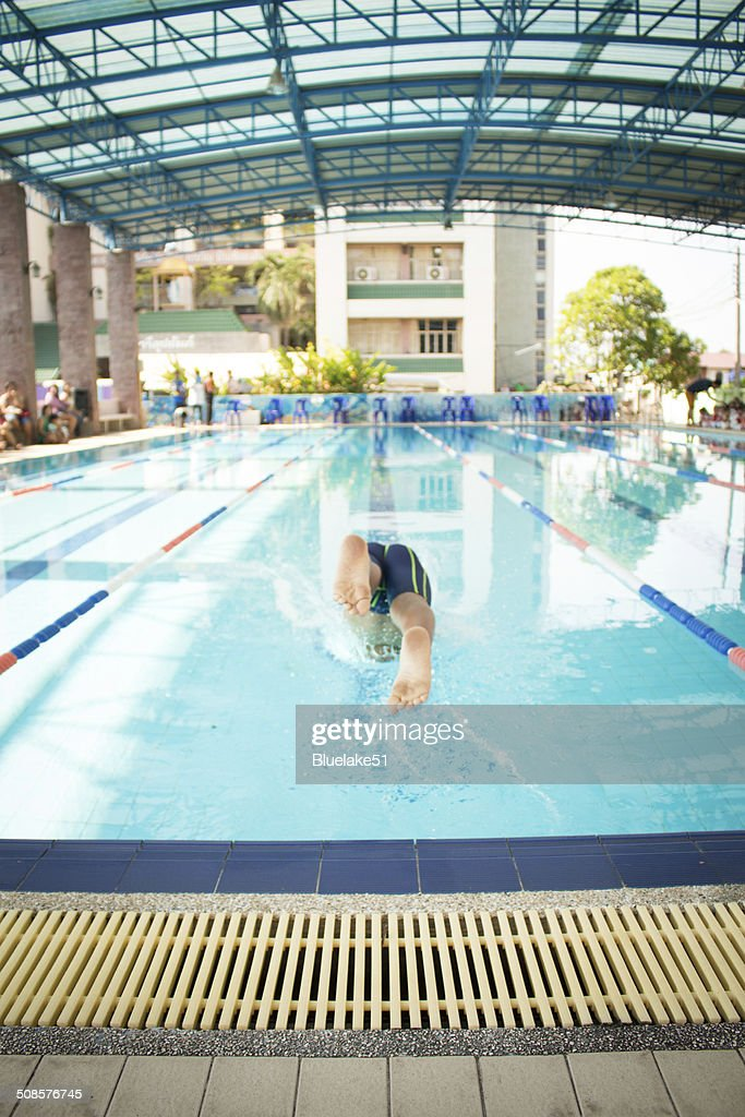 swimmer jump to swimming : Bildbanksbilder
