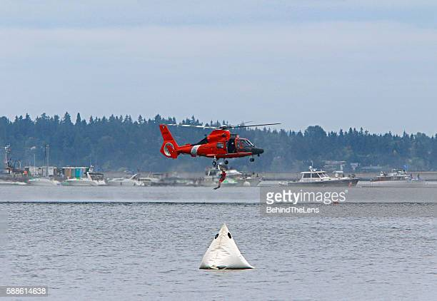 Swimmer jumping from Coast Guard Copter