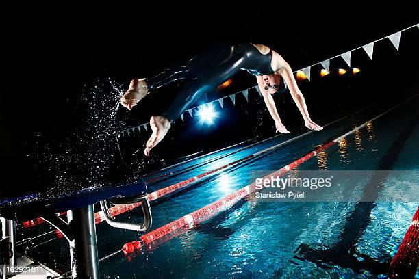 Swimmer jumping from starting platform