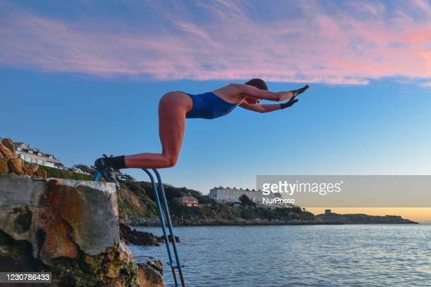 Swimmer jumps into the sea at the Vico bathing place, Hawk Cliff, in Dalkey, during Level 5 Covid-19 lockdown. On Monday, 25 January in Dublin,...