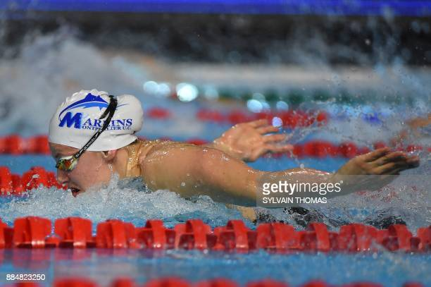 Swimmer Marie Wattel competes in the Women's 100meters butterfly final at the 25m French swimming championships in Montpellier on December 3 2017 /...