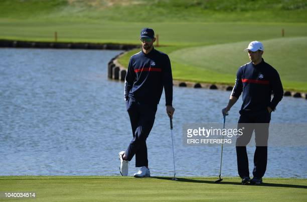 TOPSHOT US swimmer Michael Phelps and US singer Nick Jonas take part in a celebrity match ahead of the 42nd Ryder Cup at Le Golf National Course at...