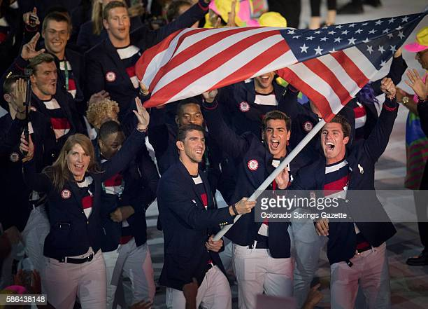 Swimmer Michael Phelps carries the flag to lead the US team during the opening ceremonies of the Summer Olympic Games on Friday Aug 5 at Maracana...
