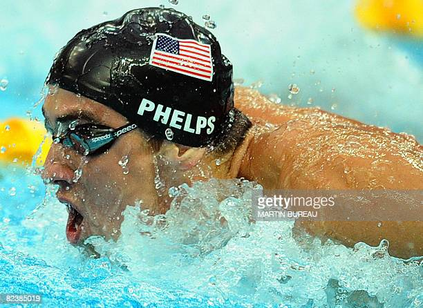 Swimmer Michael Phelps competes during the men's 4 x 100m medley relay swimming final at the National Aquatics Center during the 2008 Beijing Olympic...