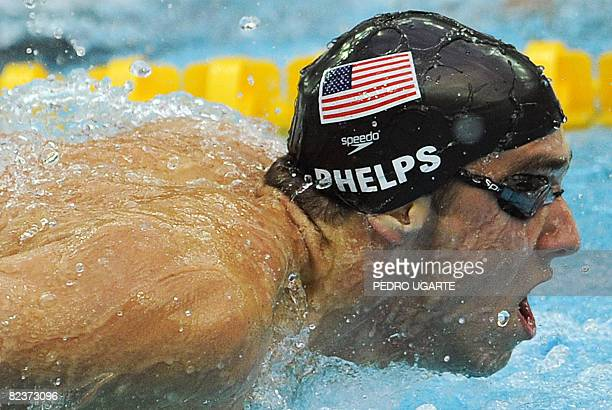 US swimmer Michael Phelps competes in the men's 100m butterfly swimming final at the National Aquatics Center during the 2008 Beijing Olympic Games...