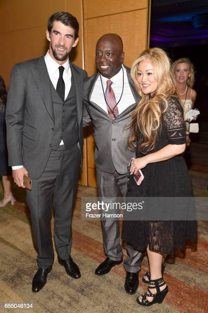 Swimmer Michael Phelps creator of the Tae Bo exercise program Billy Banks and Tomoko Sato attend Muhammad Ali's Celebrity Fight Night XXIII at the JW...