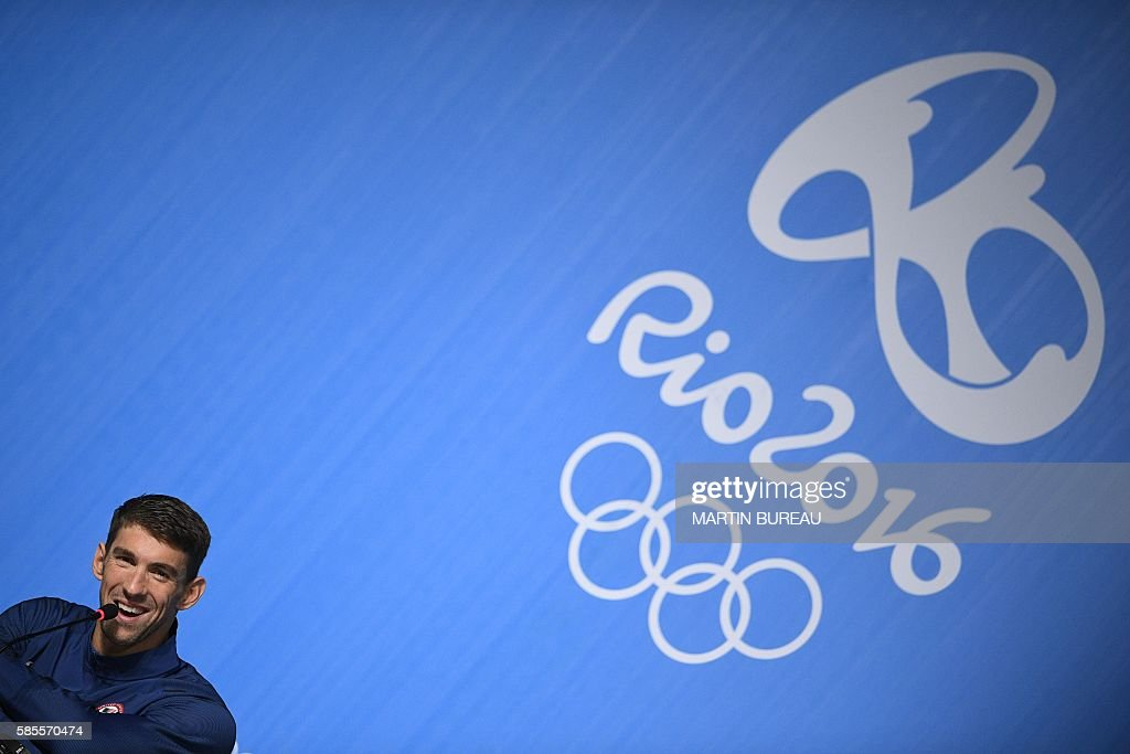 TOPSHOT - US swimmer Michael Phelps holds a press conference on August 3, 2016 in Rio de Janeiro, two days prior the opening ceremony of the Rio 2016 Olympic Games. Phelps will carry the United States flag at the opening ceremony for the Olympics in Rio, the US Olympic Committee said. / AFP / MARTIN