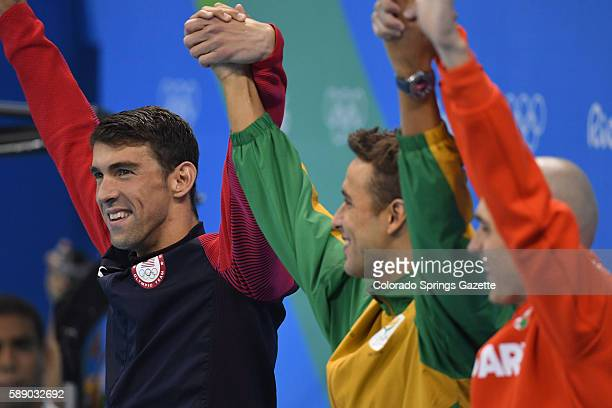 US swimmer Michael Phelps left joins hands with South Africa's Chad Guy Bertrand le Clos center and Hungary's Cseh Lazo Maya after they tied for the...