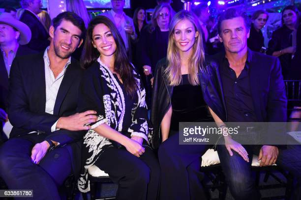 Swimmer Michael Phelps models Nicole Phelps and Kathyrn Boyd and actor Josh Brolin attend the Giving Back Fund's 8th Annual Big Game Big Give Charity...