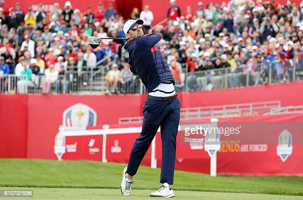 Swimmer Michael Phelps of the United States hits off the first tee during the 2016 Ryder Cup Celebrity Matches at Hazeltine National Golf Club on...