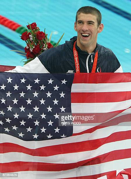 Swimmer Michael Phelps poses after the men's 4 x 100m medley relay swimming final medal ceremony at the National Aquatics Center during the 2008...