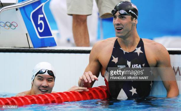 US swimmer Michael Phelps reacts as South Korea's Park Taehwan looks on after the men's 200m freestyle swimming final at the National Aquatics Center...