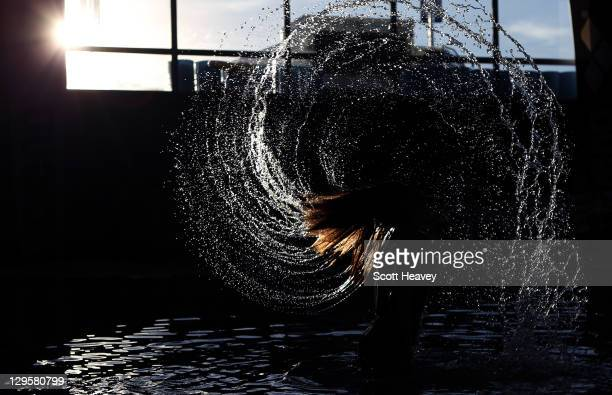 Swimmer Michelle McKeehan of the United States whirls her hair in the bathing pool before the start of the evening session during Day Four of the XVI...