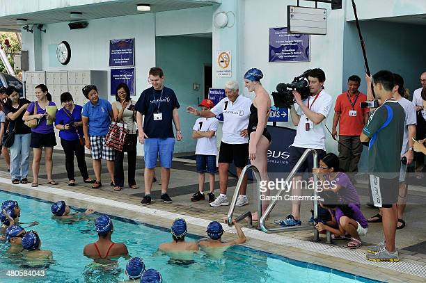 Swimmer Missy Franklin and Laureus World Sportswoman of the Year nominee and Laureus Academy Member Dawn Fraser give a swimming lesson to local...
