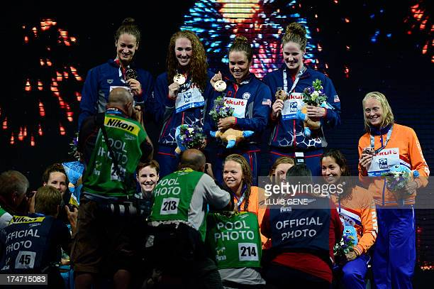 US swimmer Missy Franklin US swimmer Natalie Coughlin US swimmer Shannon Vreeland and US swimmer Megan Romano celebrate on the podium during the...