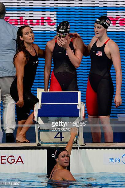 US swimmer Missy Franklin US swimmer Shannon Vreeland US swimmer Natalie Coughlin and US swimmer Megan Romano react after winning the final of the...
