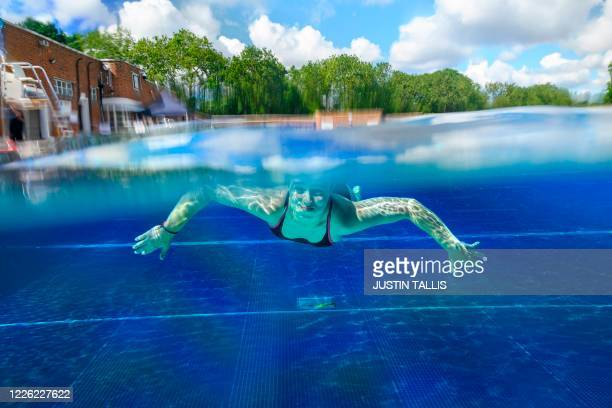 Swimmer moves under the water at Parliament Hill Lido in London on July 11 as restrictions are further eased during the novel coronavirus COVID-19...