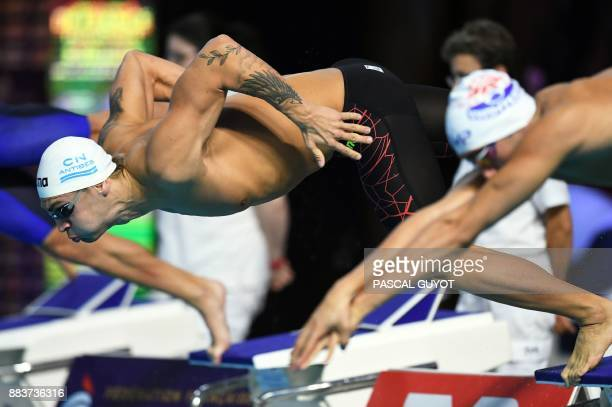 Swimmer Nans Roch competes in the final of the men's 200meters butterfly 25m French swimming championships in Montpellier on December 1 2017 / AFP...