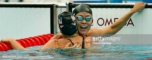 USA swimmer Natalie Coughlin shares her winning moment with teammate Margaret Hoelzer after winning medals in the Women's 100m Backstroke at the...