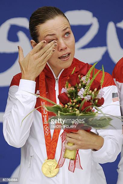 US swimmer Natalie Coughlin stands on the podium of the women's 100m backstroke swimming medal ceremony at the National Aquatics Center in the 2008...