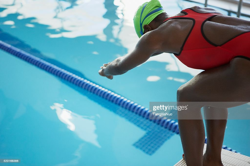 Swimmer on a starting block : Stock Photo