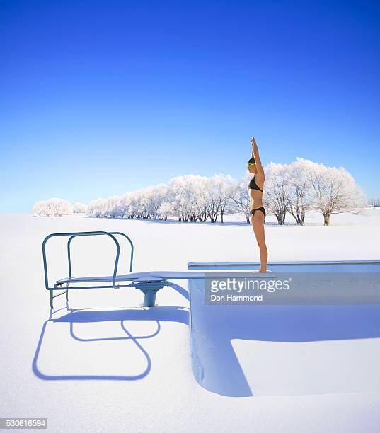 Swimmer on Diving Board in Winter