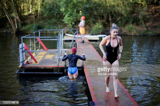 Swimmer prepares to enter the water at the Hampstead Heath ponds in London on March 30 as Covid-19 lockdown restrictions ease to allow outdoor...