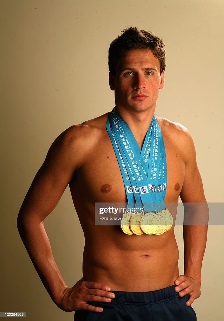 Ryan lochte portrait session photos and images getty images swimmer ryan lochte poses with the gold medals he recently won at the 2011 fina world voltagebd Choice Image
