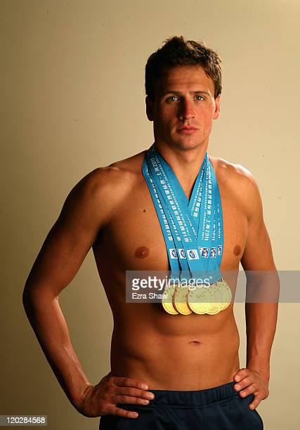 Swimmer Ryan Lochte poses with the gold medals he recently won at the 2011 FINA World Championships during a photo shoot on August 3 2011 at the...