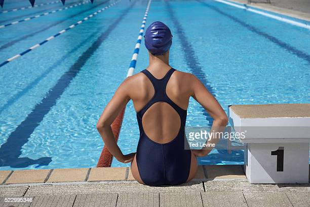 Swimmer Sitting at Pool's Edge
