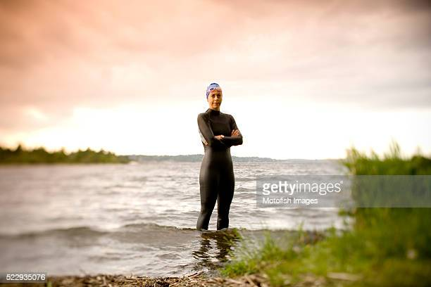 Swimmer Standing on Lakeshore