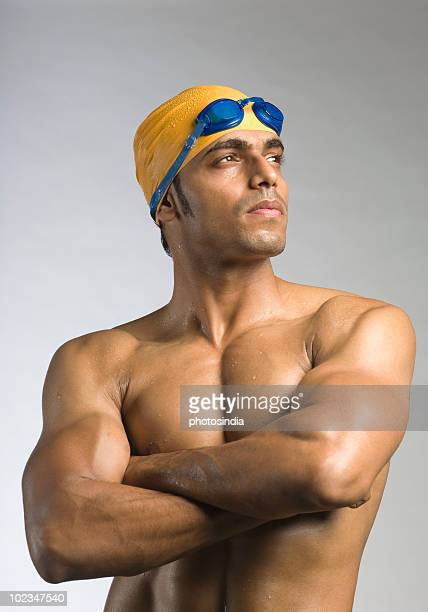 Swimmer standing with his arms crossed