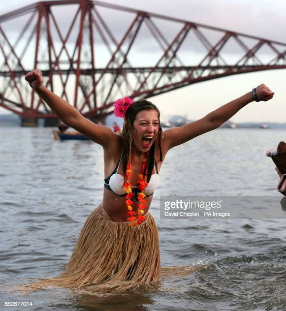 A swimmer takes part in the loony dook New Year's Day dip in the Firth of Forth at South Queensferry as part of Edinburgh's threedaylong Hogmanay...